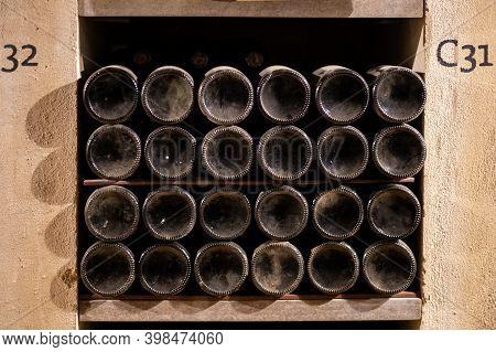 Bottles Of Vintage Fortified Ruby Or Tawny Porto Wine In Old Cellars Of Vila Nova De Gaia, Portugal