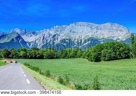 Panoramic View On Breche De Faraut Mountain Range In French Prealps In Summer