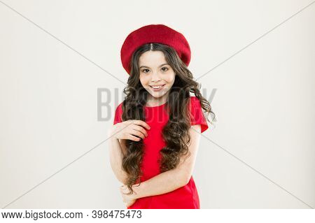 Summer Fashion Beauty. Happy Girl With Long Curly Hair In Beret. Childhood. Hairdresser Salon. Shy L