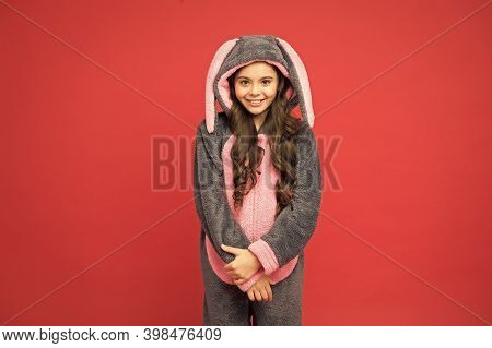Cute Everyday. Cute Child Red Background. Cute Girl Wear Bunny Pajamas. Small Kid With Cute Look. Ea