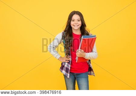 Back To School. Happy Kid Hold Books Yellow Background. School Library. Literature Lesson. Knowledge
