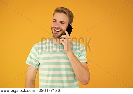 Importance Of Being Communicative. Happy Man Talk On Mobile Phone Yellow Background. Verbal Communic