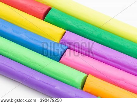Isolated Multi Colors Of Clay Sticks On White Background