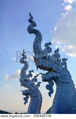 Holy Guardian Of White Serpent At Buddhist Temple In Chiang Rai, Thailand. It Is A Mythical Animal W