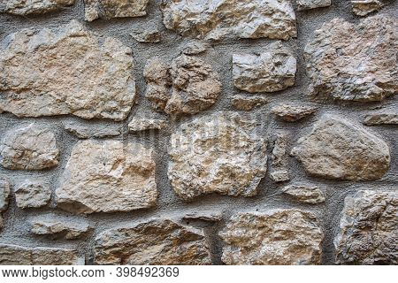 Stone Wall Of Large Stones. Rustic Grey Stone Wall Texture. Part Of A Stone Wall, For Background Or