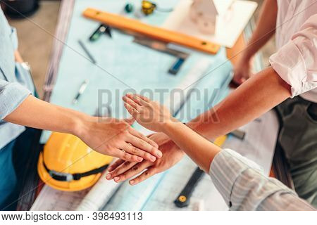 Engineer And Architect Partners Team Work Join Hands Together. Group People Hands Were Collaboration