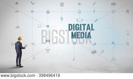 Engineer working on a new social media platform with DIGITAL MEDIA inscription concept