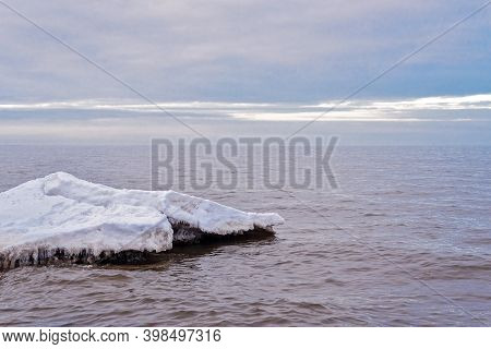 The Baikal Lake In Winter With A Surface Covered With A Thick Layer Of Transparent Cracked Ice And I
