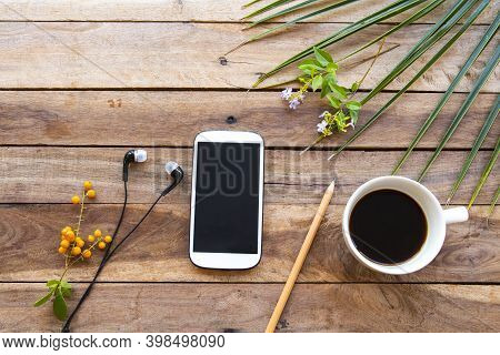 Mobile Phone ,hot Coffee Espresso With Leaves Arrangement Flay Lay Style On Background Wooden