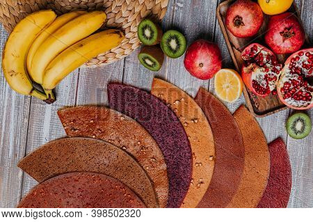 Many Colorful Fruit Leathers With Fresh Fruits On The Wooden Table. Round Fruit Leather. Healthy Foo