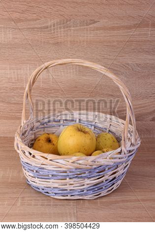 Basket with fresh fruits on a wooden table