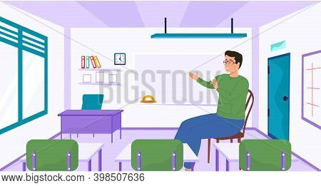 A Man School Worker, Teacher In Empty Classroom At School Workplace. Education And Training. Back To