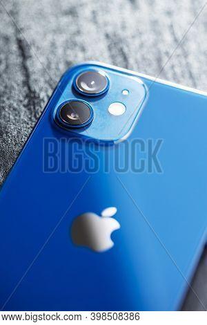 PRAGUE, CZECH REPUBLIC - DECEMBER 05 2020: Camera lenses on blue Iphone 12 mini, detail of Iphone 12 back.