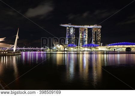 Singapore, Republic Of Singapore - December 16, 2019: Panoramic Skyline Of Singapore By Night, With