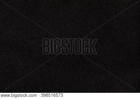 Dark Grey Background From Textile Material With Wicker Texture. Structure Of Black Fabric As Pattern
