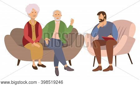 Old Man And Woman Are Sitting On A Large Brown Sofa. The Psychologist Is Sitting With A Paper And As