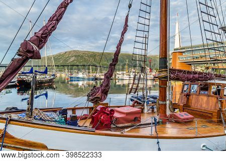 Old Ship In The Harbor In The Center Of Tromso In Northerm Norway