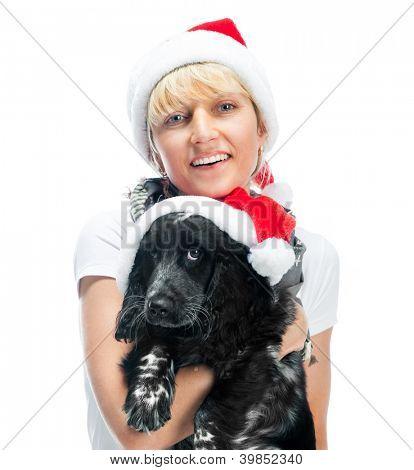 smiling woman and dog in santa hat at Christmas
