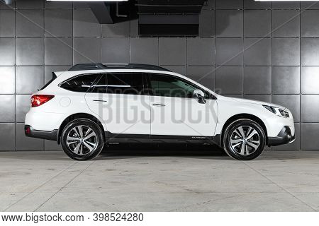 Novosibirsk, Russia - December 07, 2020:  New White Subaru Outback , Side View.  Photography Of A Mo