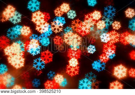 Christmas background. Christmas festive background. Blurred Christmas background, holiday Christmas glowing color lights with sparkles, blurred Christmas bright abstract bokeh, Christmas festive background