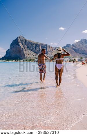 Couple Men And Woman Mid Age On Vacation At The Italian Island Sicily Visiting The Beach Of San Vito