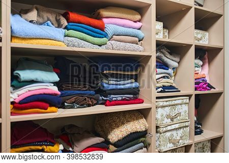 Large Wardrobe With Different Clothes, Home Stuff And Shoes . Hangers With Different Clothes In Ward