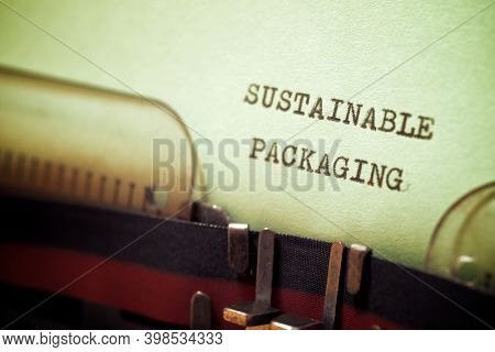 Sustainable packaging phrase written with a typewriter.