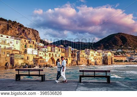Couple On Vacation Sicily Visiting The Old Town Of Cefalu, Sunset At The Beach Of Cefalu Sicily, Old