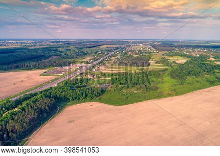 Aerial View Of Highway, Countryside And Arable Fields