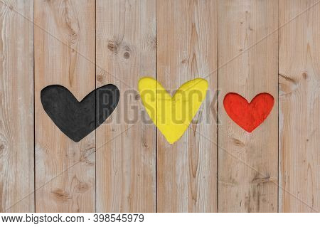 Belgian Flag Colors Carved Into Wooden Love Hearts