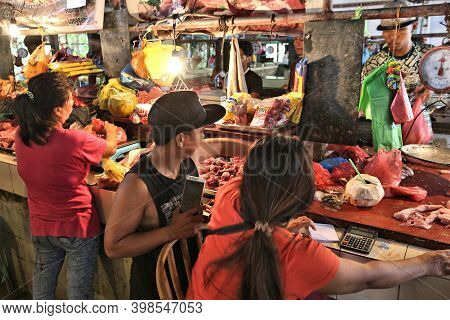 El Nido, Philippines - December 2, 2017: Vendors Sell Meat At A Local Food Market Place In El Nido,