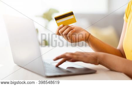 Ecommerce Concept. Side View Of Unrecognizable African American Young Lady Holding Debit Credit Card