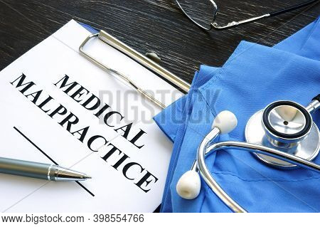 Medical Malpractice. Medical Suit, Stethoscope And Documents.
