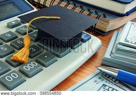 Student Loan Concept. Graduation Cap On The Calculator.