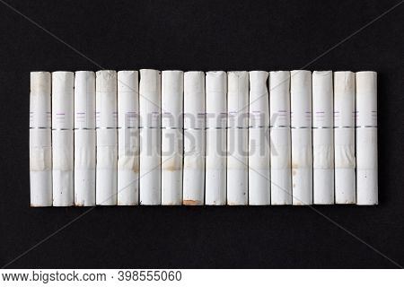 A Row Of Cigarette Butts Of The Tobacco Heating System On A Dark Background. Alternative To Traditio