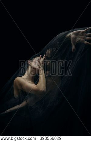 Body Warm. Graceful Classic Ballet Dancers Isolated On Black Studio Background. Couple In Minimalist