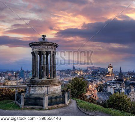 Panorama Of Edinburgh Against Sunset With Calton Hill And Edinburgh Castle In Scotland, United Kingd