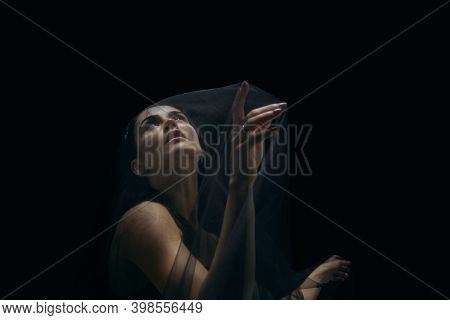 Touch. Graceful Classic Female Ballet Dancer Isolated On Black Studio Background. Woman In Minimalis