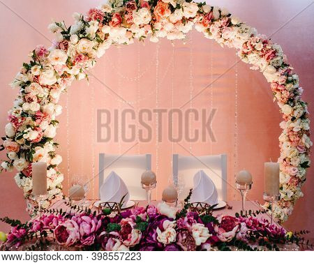Festive Table, Arch, Stands Decorated With Composition Of Violet, Purple, Pink Flowers And Greenery,