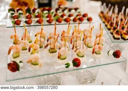 Assorted Mini Canapes On Table. Restaurant Food At Event. Delicacies And Snacks On Buffet Table. Sea