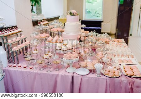 Sweet Table. A Plates Of Cakes And Muffins With Cream. Table With Sweets, Candy, Buffet. Dessert Tab