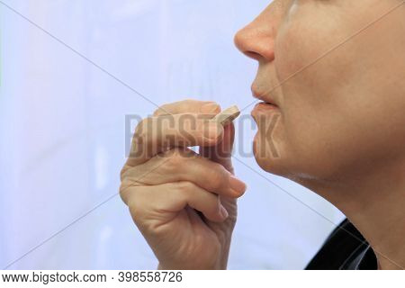 Close Up Mature Middle-aged Woman At Home Holding Pill . Headaches, Arthritis,  Depression, Medicine