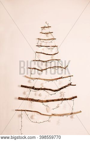 Hanging On The Wall Alternative Wooden Christmas Tree With Wooden Tree Decorations. Christmas And Ne