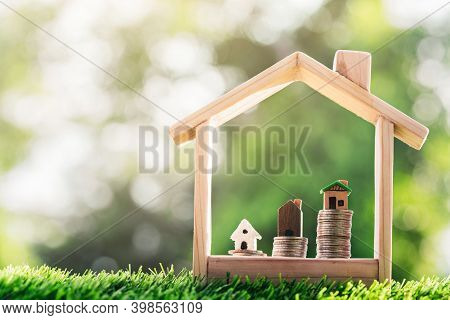 House On The Coins Placed Is A Staircase In A Model House On The Grass. Planning Savings Money Of Co