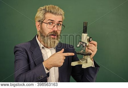 School Teacher Looking Microscope. Biological Research. Facilitate Academic Progress. Scientific Res