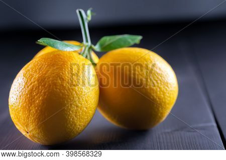 Ripe Lemons With Twig And Leaves.ripe Lemons With Twig And Leaves