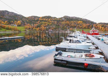 Coastal Norwegian Landscape With Small Boats Moored At Floating Pier. Snillfjord, Sor-trondelag, Vin