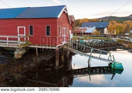 Norwegian Fishing Village, Red Wooden Barn Stands On The Sea Coast. Snillfjord, Sor-trondelag Region