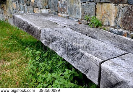 Gray Stone Wall With Solid Wood Bench Folded Without Cement And Concrete. Stone Quartzite Durable Re