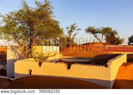 Al Madam Ghost Town Buildings And Walls Buried In Sand Dunes In The Desert Of Sharjah, United Arab E